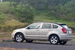 sedan(0.0), automobile(1.0), sport utility vehicle(1.0), dodge(1.0), vehicle(1.0), dodge caliber(1.0), compact sport utility vehicle(1.0), mid-size car(1.0), crossover suv(1.0), land vehicle(1.0),