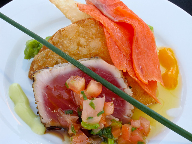 Seared rare Ahi tuna, avocado salad, crispy won ton and smoked salmon from Carmelo's