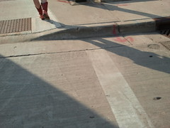 floor(0.0), outdoor structure(0.0), wood(0.0), wing(0.0), roof(0.0), driveway(0.0), lane(0.0), flooring(0.0), pedestrian crossing(0.0), asphalt(1.0), sidewalk(1.0), road(1.0), concrete(1.0), road surface(1.0), infrastructure(1.0),