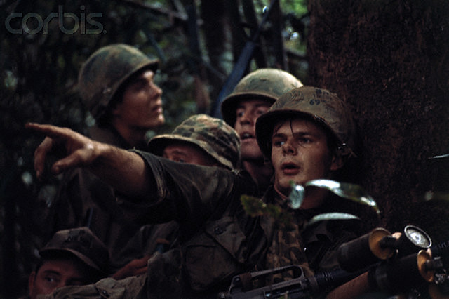 Activities atop Hill 875 following its capture by elements of the 173rd Airborne Brigade, conquest of Hill 875 ended five days of the bitterest fighting of the Vietnam War, 1967, by Kyoichi Sawada