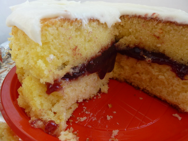 Yellow cake with cherry jam filling and white chocolate frosting ...