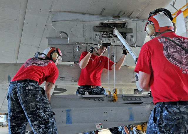 Sailors lift an AGM-65 Maverick air-to-ground tactical missile to a P-3C Orion aircraft