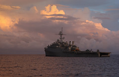 In this file photo, amphibious transport dock ship USS Cleveland (LPD 7) sits off the coast of the Federated States of Micronesia July 12, 2011, during the fifth phase of Pacific Partnership 2011. (Royal Australian Navy Leading Seaman Imagery Specialist Helen Frank)