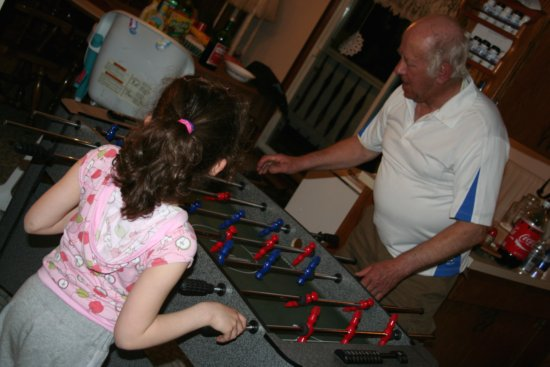 Kaylie and Opa play Foosball