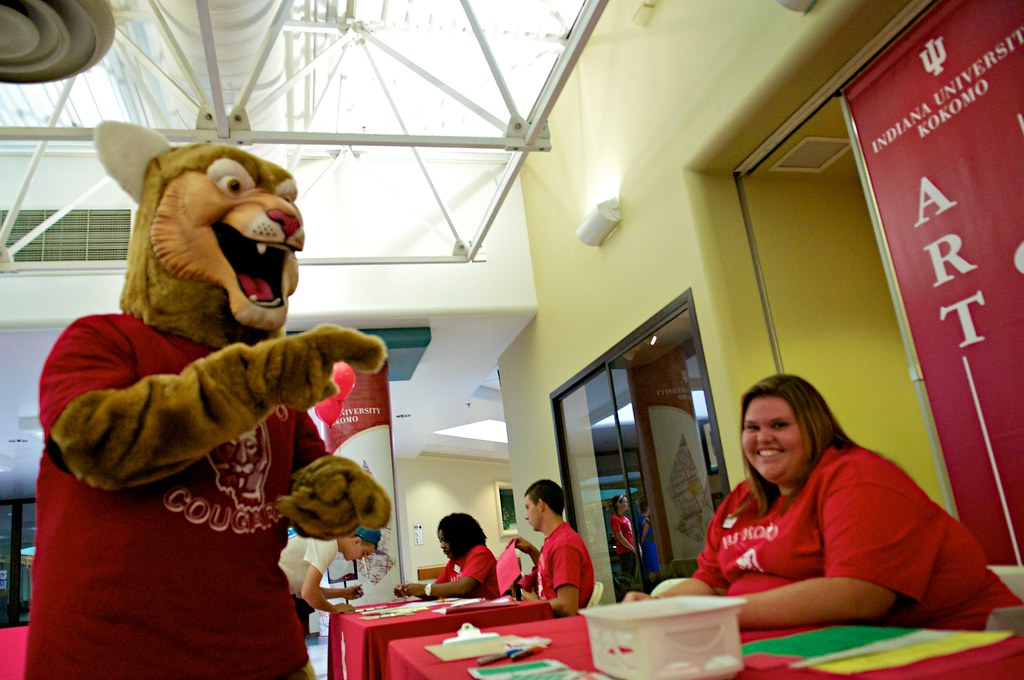 Psychology major Amanda Smith has a laugh with Kingston Cougar at New Student Orientation