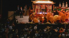 Crowd scene, His Holiness the Great 14th Dalai Lama putting on his shoes, departing the large Buddhist crowd, Kalachakra for World Peace, Buddhist monks, nuns, laypeople, homeland security, security, pavillon, Verizon Center, Washington D.C., USA