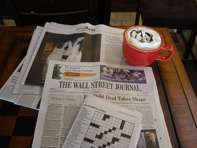 Sunday Mornings reading the paper at a café
