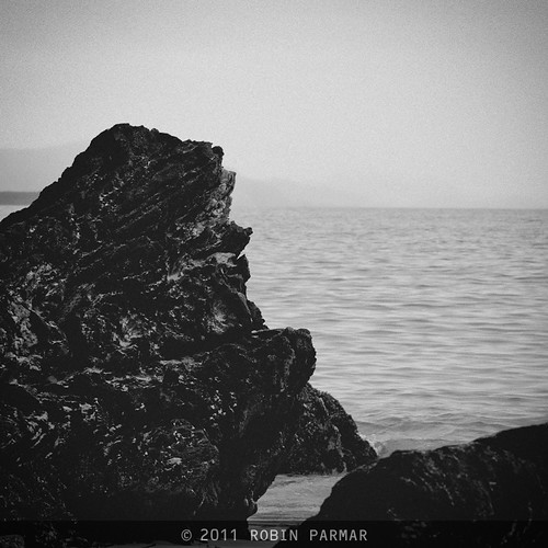 rock / sea / sky / rain