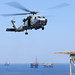 An HH-60H Sea Hawk helicopter prepares to land on a gas and oil platform