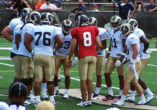 Sam Bradford quarterbacks a practice huddle