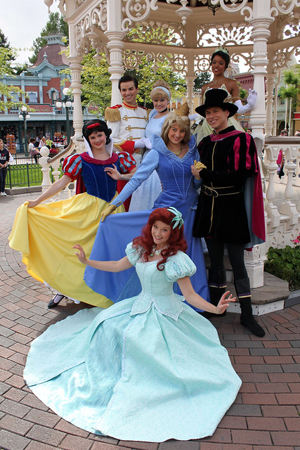 The Princes and Princesses pose for pictures in Town Square