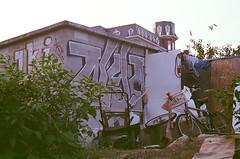 Graffiti, bike, and clothesline