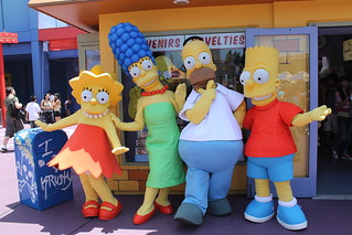 The Simpsons outside of the Kwik-E-Mart