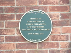 Photo of George VI, Elizabeth II, and Margaret green plaque