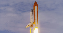 missile(0.0), mast(0.0), tower(0.0), rocket(1.0), space shuttle(1.0), spacecraft(1.0), vehicle(1.0), sky(1.0),
