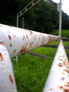 Rusty Fence Rail at Vacant Farm