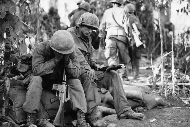 Battle weary men of the U.S. 173 Airborne Brigade pause for a moment's rest. American troops went to the top of hill 875 after some of the bloodiest fighting of the Vietnam War, 1967, unattributed