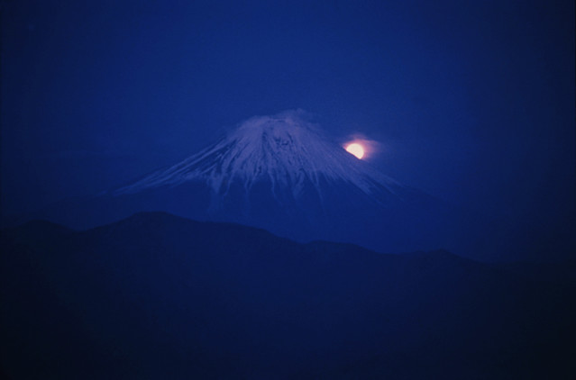 Full moon rising over Mount Fuji viewed from Mount Sichimen, 1961, by Burt Glinn