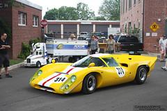 porsche 906(0.0), race car(1.0), automobile(1.0), porsche 910(1.0), vehicle(1.0), automotive design(1.0), sports prototype(1.0), antique car(1.0), land vehicle(1.0), supercar(1.0), sports car(1.0),