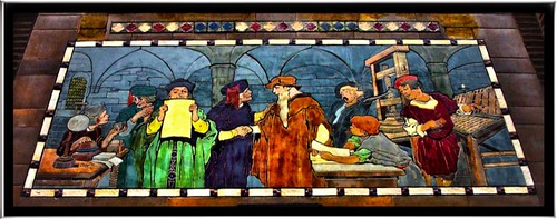 "Franklin Building ~ ""The First Impression"" depicts men working at the Gutenberg press."
