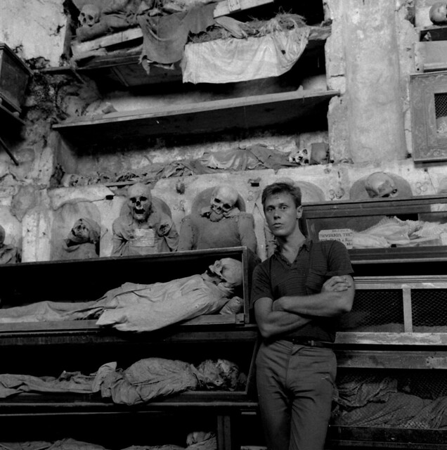 Paul Thek in the Palermo Catacombs, 1963, by Peter Hujar