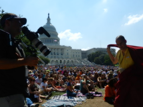 Photographer and Tibetan Buddhist monk, US Capitol building, crowd sitting on the western capitol lawn listening to His Holiness the 14th Dalai Lama speak about peace and religion, Kalachakra for World Peace, Washington D.C., USA by Wonderlane