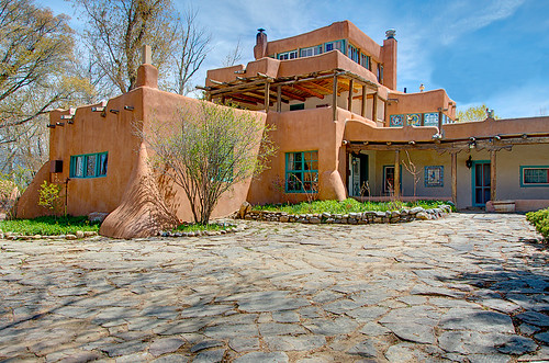 In 1919 Mabel Dodge Sterne moved to Taos, New Mexico and started a literary colony there. Today as you approach the house of Mabel Dodge Luhan, it's easy to see why some of the greatest minds of the 20th century were inspired here. Situated at the end of a quiet road not far from the center of town, the house appears much as it did in the days when Mabel admired her views of the sacred Taos Mountain from the third-story solarium. One can only imagine the tantalizing conversations that must have taken place within these walls. After all, Georgia OKeeffe stayed here. So did D.H. Lawrence, Ansel Adams, Martha Graham and Carl Jung, among many other notables. As an historic inn and conference center which offers retreat-style meetings and artistic, literary, and personal growth workshops, the Mabel Dodge Luhan House continues to build on its 80-year history of personal, intellectual and artistic ferment. Dennis Hopper wrote the script for Easy Rider at the house Hopper ensconced himself at the Mabel Dodge Luhan House in Taos, New Mexico, which he later purchased in 1970.
