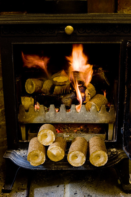 Compressed Logs For Wood Stoves ~ Compressed wood chip and sawdust pellets burning in a