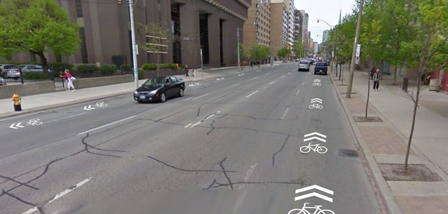 Thu, 07/14/2011 - 10:48 - This is a fictional future. The image is from Google Streetview which is out of date - Jarvis currently has bike lanes. City Council just voted to remove them (jerks!) so we may see some day soon again a 5 car lane highway on this urban street.</p> <p>So if we&#039;re stuck with politicians idiocy at the least we can get sharrows on this awful street.