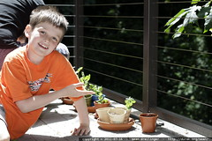 nick with his plants on the back deck