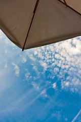 Parasol against blue sky
