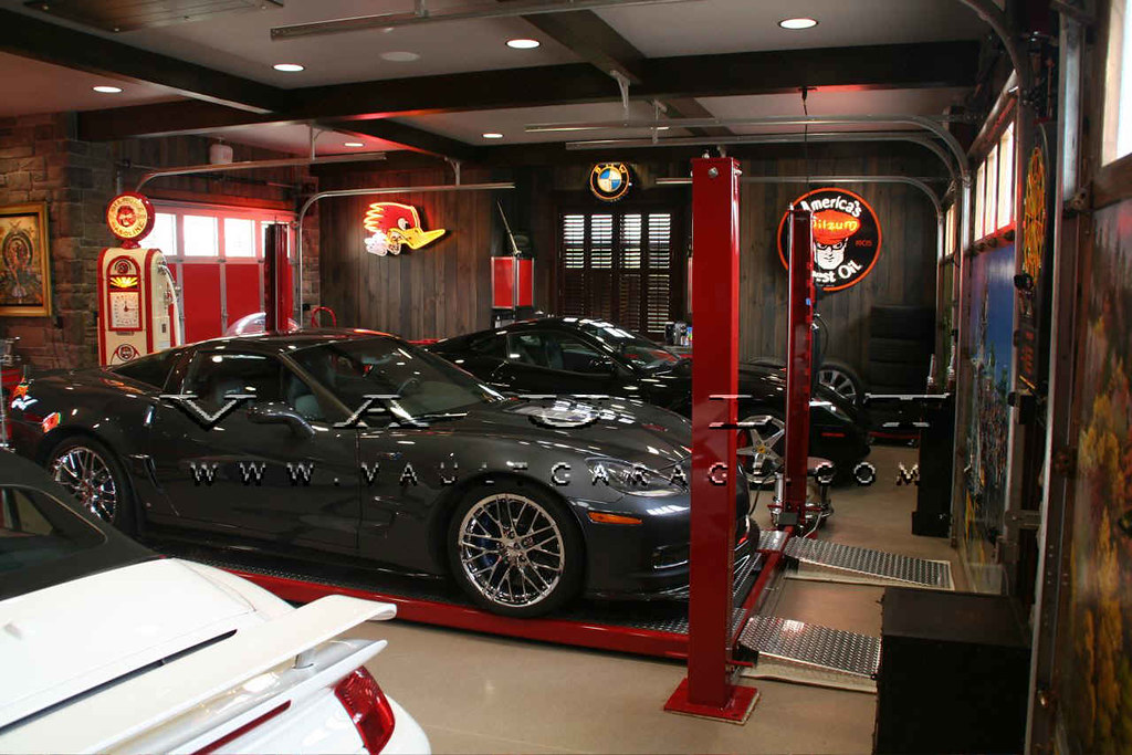Custom garage design and furnished by vault by for Vault garage cabinets pricing