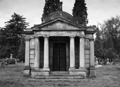 cemetery(0.0), ancient history(1.0), building(1.0), monochrome photography(1.0), place of worship(1.0), monochrome(1.0), mausoleum(1.0), black-and-white(1.0),