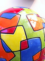 automotive exterior(0.0), wheel(0.0), glass(0.0), player(0.0), ball(0.0), ball(1.0), football(1.0),