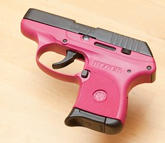 handgun(1.0), magenta(1.0), trigger(1.0), weapon(1.0), revolver(1.0), firearm(1.0), gun(1.0), pink(1.0),