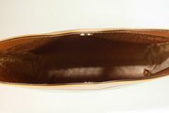 footwear(0.0), shoe(0.0), strap(0.0), ballet flat(0.0), bag(1.0), textile(1.0), brown(1.0), coin purse(1.0), leather(1.0), tan(1.0),