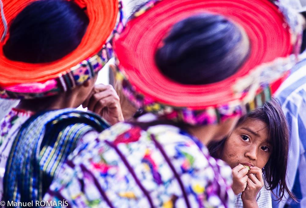 Guatemala, sweet little girl, colored hats