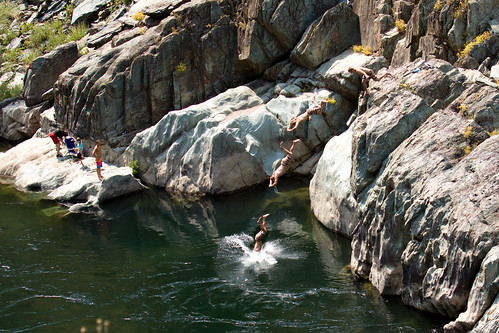 dive diving american river north fork kid kids jumping jump water stream rock rocks boulders cold freezing hot day cooling off clone action sports extreme cloning photoshop sequence summer fun play acting activity vacation canon 50d photo photograph multiplicity sport
