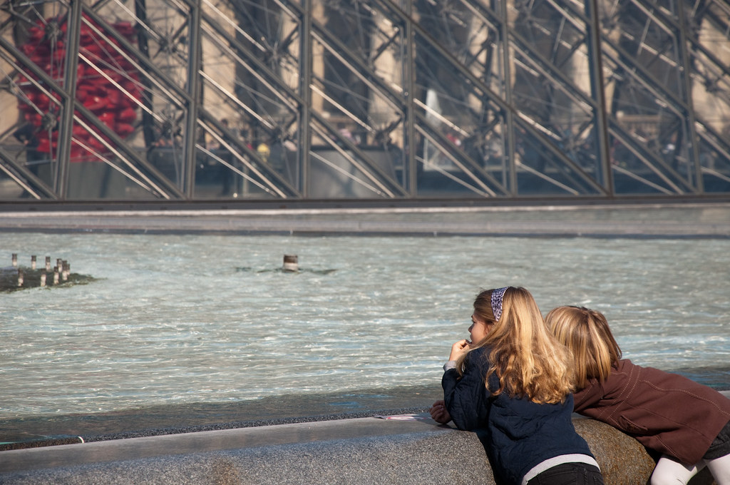 Kids outside of Musee du Louvre. Pyramid Paris