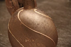 pottery(0.0), drinkware(0.0), bottle(0.0), lighting(0.0), art(1.0), brown(1.0), metal(1.0), close-up(1.0), ceramic(1.0), bronze(1.0),