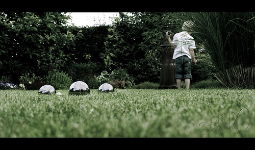 boy summer playing grass june garden denmark kid child lawn olympus scandinavia zuiko petanque malthe 2011 e420 bocceballs havinganicetime jonnasbirthdayparty jonnaolesgarden
