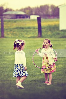 Little girls with a hula hoop