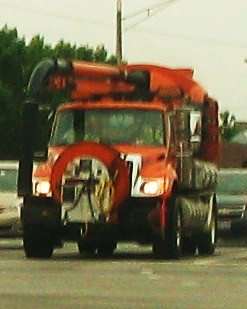 An orange International sewer maintenance truck. Morton Grove Illinois USA. Early August 2011. by Eddie from Chicago