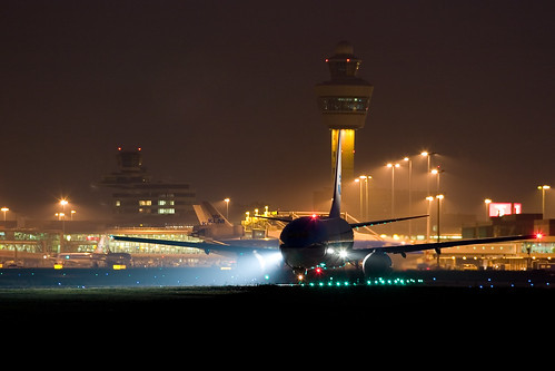 KLM Beoing 737 in front of the Schiphol Control Towers