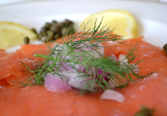 salmon-like fish(0.0), fish(0.0), produce(0.0), salmon(1.0), vegetable(1.0), fish(1.0), garnish(1.0), lox(1.0), food(1.0), dish(1.0), cuisine(1.0), smoked salmon(1.0),