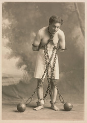 Studio photograph of Houdini in white trunks and chains, c. 1905 by Skirball Cultural Center