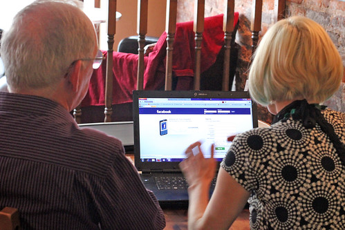 Melissa helping someone learn about Facebook at Dudley Social Media Surgery