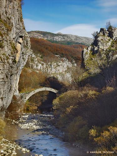 river greece oaks oaktrees stonebridge archedbridge kipi epirus digitalcameraclub zagori canyongorge mountainscliff blinkagain