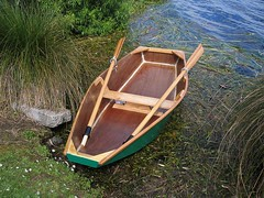 canoe(0.0), sailboat(0.0), watercraft rowing(0.0), motorboat(0.0), caravel(0.0), boats and boating--equipment and supplies(1.0), dinghy(1.0), vehicle(1.0), skiff(1.0), boating(1.0), watercraft(1.0), oar(1.0), boat(1.0), paddle(1.0),