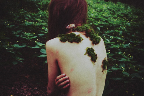 fairy tale about a small girl who slept in the woods and woke up being overgrown by moss and mushrooms. now she is a part of the woods. by laura makabresku